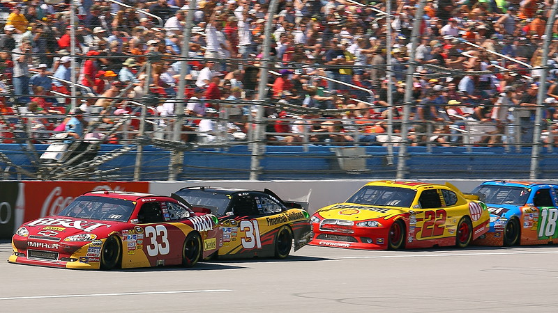Talladega crowd on its feet as Bowyer Burton Harvick and Kyle Busch speed by at 200 mph