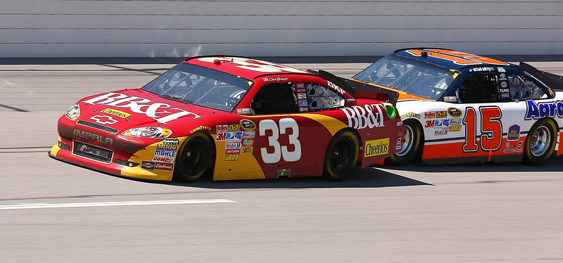 Bowyer being pushed by Waltrip Talladega Aaron's 499
