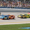Lovebugs usually seen more often along the Gulf Coast pass by fans at Talladega during the Aaron's 499