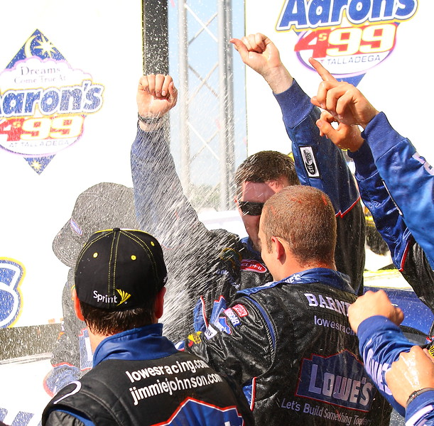 Champagne flies in Victory lane Talladega Aaron's 499
