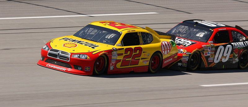 Landon Cassill pushes Kurt Busch down the front stretch at Talladega
