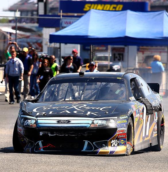 Matt Kenseth enters garage area at Talladega with his No 17 Crown Royal Black Ford