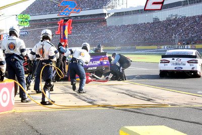 ...Crew members chase after it into the next pit.