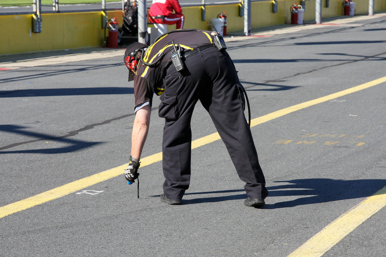 A crew member checks the temperature of the track