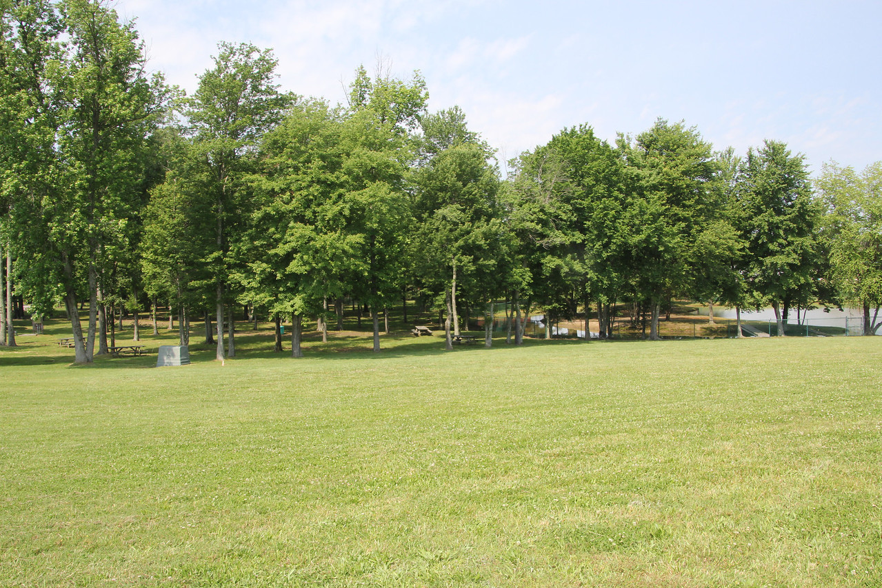 Shade and picnic tables are located all around the track.