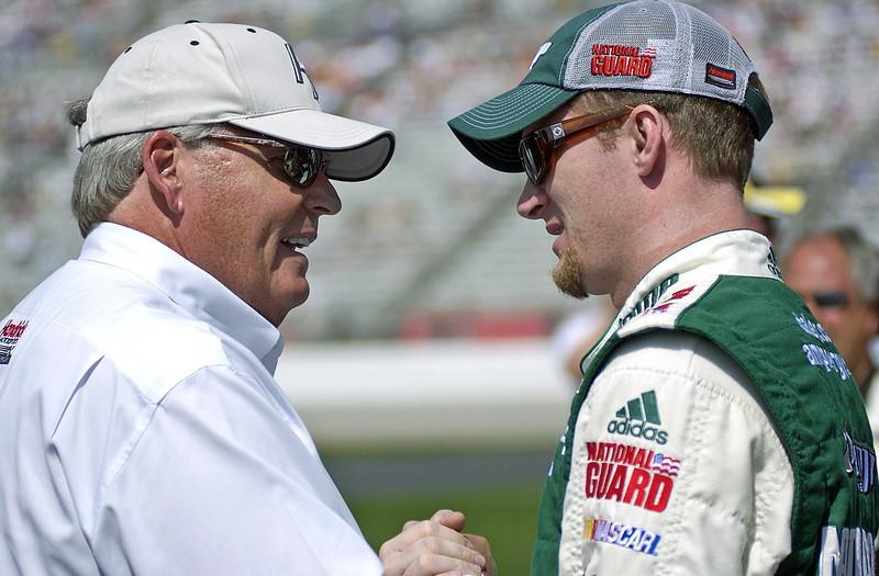 Hendrick Motorsports owner Rick Hendrick talks with driver Dale Earnhardt Jr. before the Kobalt Tools 500 n Atlanta.