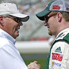 Hendrick Motorsports owner Rick Hendrick talks with driver Dale Earnhardt Jr. before the Kobalt Tools 500 n Atlanta.