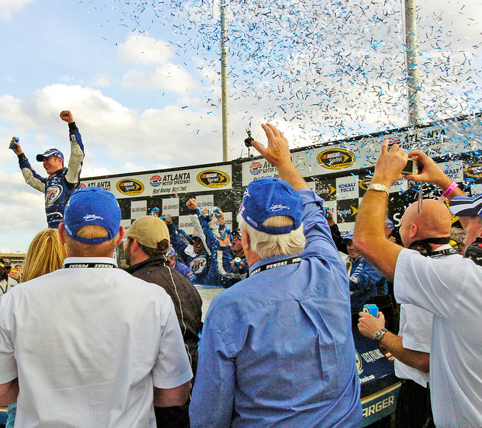 Kurt Busch celebrates the win of the Kobalt Tools 500 at Atlanta Motor Speedway.<br />  PHOTO BY JOE LIVINGSTON/STAFF