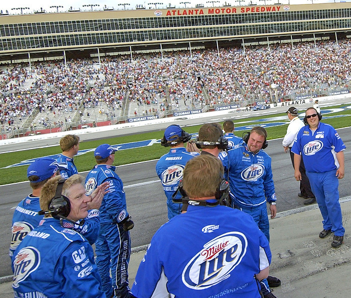 Miller Lite Pit Crew smile and watch as driver Kurt Busch gets the checkered flag from the flagman and starts his reverse Victory Lap..