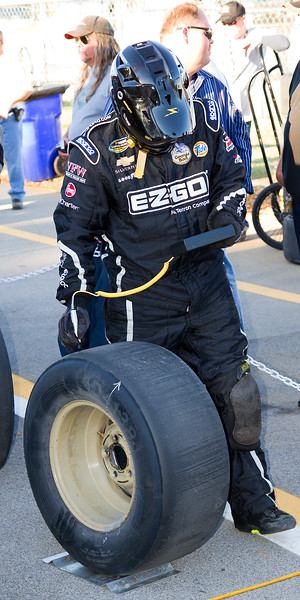 Ron Hornaday Team Member verifies that each tire is the proper pressure during the 2010 Mountain Dew 250 at Talladega Superspeedway.
