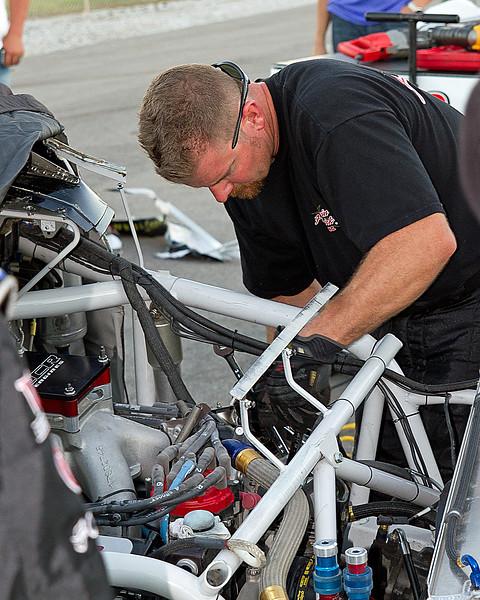 Post crash, the Hornaday Team works on Truck.