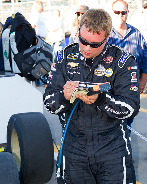 Ron Hornaday Team Member checks tire pressures during Mountain Dew 250.