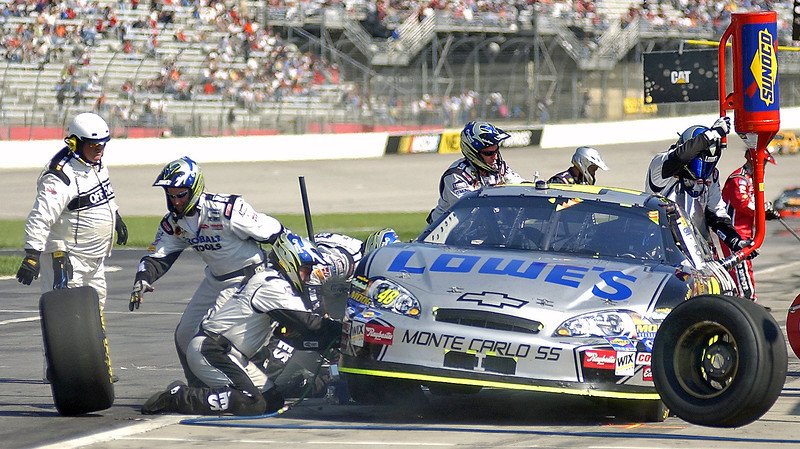 """Fresh Rubber and Fuel"" this would be Johnson's last pit stop before going on to win the race, the pit crew was in a frenzy with tires bouncing all over trying to get the car back in the race."