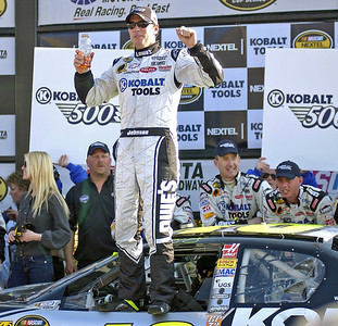 Race winner Jimmie Johnson stands in the window and gets a much needed drink after the controversial win against Tony Stewart on the last lap.