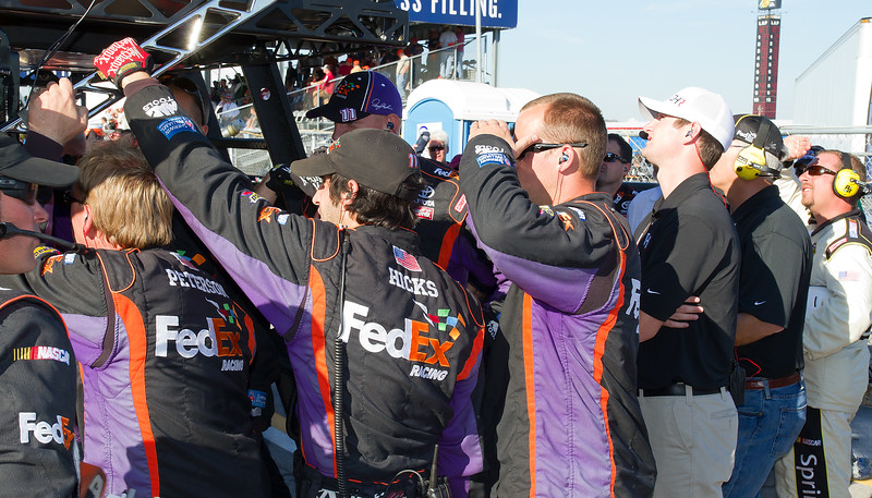 Most Pit Work Done For the Day, Many Eyes in the Denny Hamlin Pit Watch the Final Laps of the Amp Energy Juice 500.
