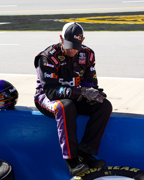 One of Denny Hamlin's Pit Crew Members Takes a Break on the Wall at Talladega