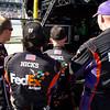 Hamlin Team Members Pegram, Hicks, Hodel, and Bolling Follow the Amp Energy Juice 500 Near the End of the Race.