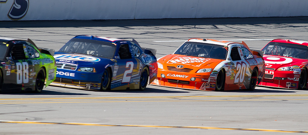 Dale Earnhardt, Jr. Followed by Kurt Busch, Joey Logano, and Juan Pablo Montoya during the 2010 Amp Energy Juice 500 at Talladega