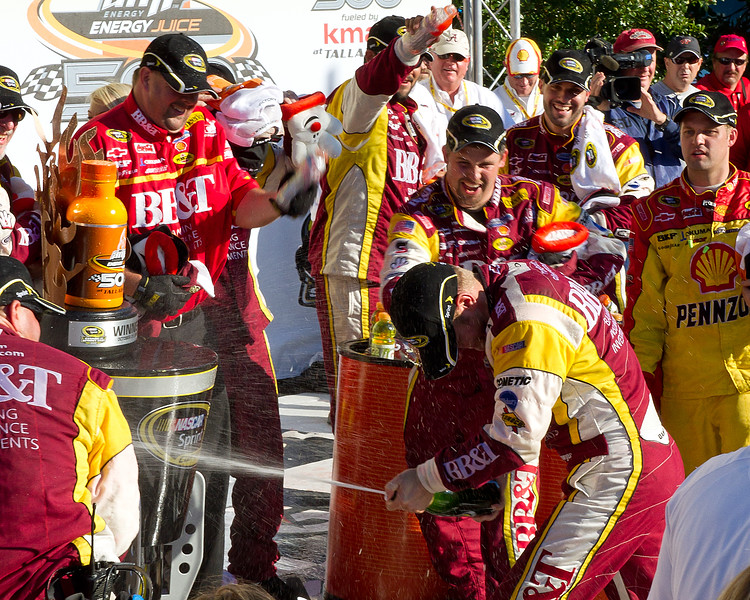 Clint Bowyer Lets the Champagne Fly After Winning the 2010 Amp Energy Juice 500 at Talladega Superspeedway.  A Directed Shot of Champagne from Bowyer in Victory Lane.