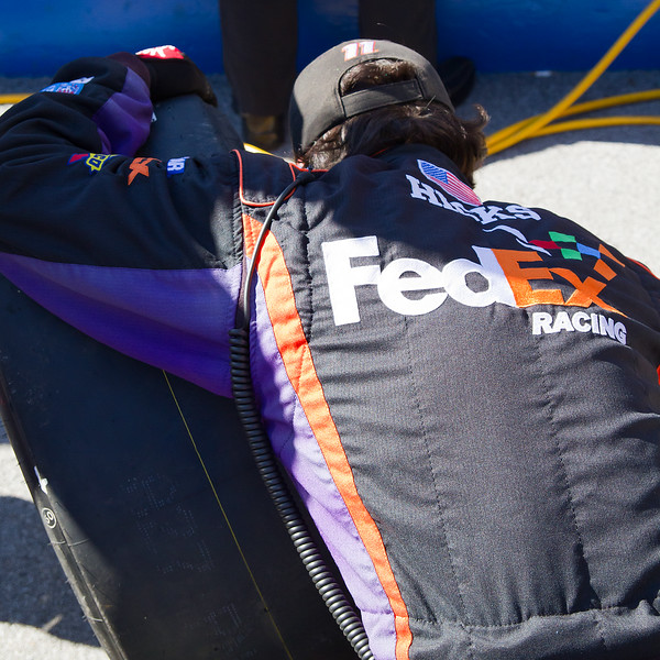 FedEx Racing Hamlin Crew Member Hicks Checks Tire During Amp Energy Juice 500 at Talladega