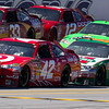NASCAR Sprint Cup Drivers Logano, Montoya, Sadler, Bowyer, Keselowski, and Martin Pass in Front of Pit Road 3 Wide During Amp Energy Juice 500 at Talladega Superspeedway.