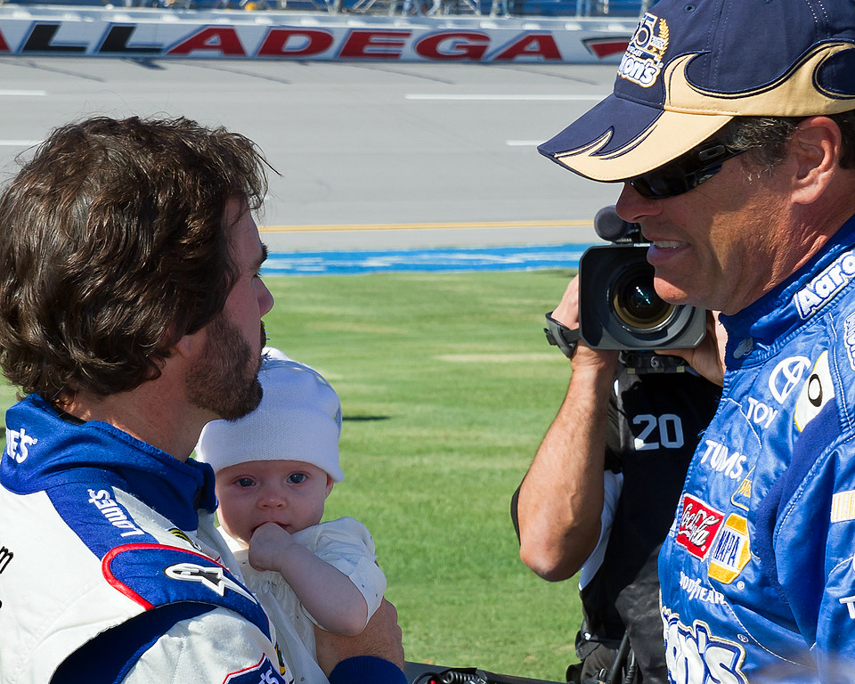 NASCAR's Michael Waltrip visits with Jimmie Johnson and daughter Genevieve Marie before start of Amp Energy Juice 500 at Talladega.