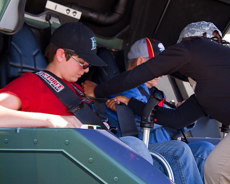Josh straps into Apache Longbow Simulator at Army Display Amp Energy Juice 500 Talladega.
