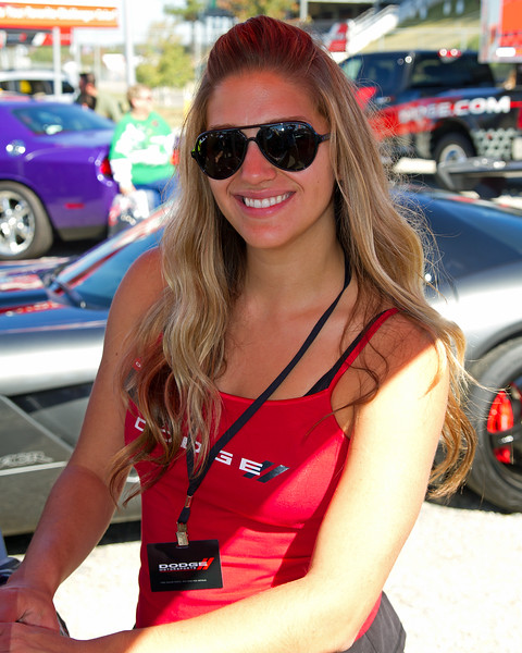 Lovely, Friendly Dodge Girl at Dodge's Fan Display at Amp Energy Juice 500 at Talladega. She and other models greeted race fans with gifts, information on Dodge products, and the models challenged fans on fans' knowledge of NASCAR Racing Trivia.