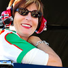 All Smiles, a Lovely Lady with a Great Heart Watches as the Sadler Hunt Brothers Pizza No. 19 Car Makes a Stong Showing.