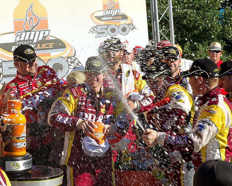 Clint Bowyer Lets the Champagne Fly After Winning the 2010 Amp Energy Juice 500 at Talladega Superspeedway. Everyone with 30 feet of Clint and his Team in Victory Lane was Covered with Champagne.