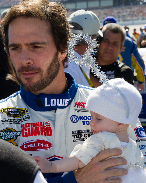 Jimmie Johnson and daughter Genevieve Marie answering questions prior to the start of the Amp Energy Juice 500 at Talladega.
