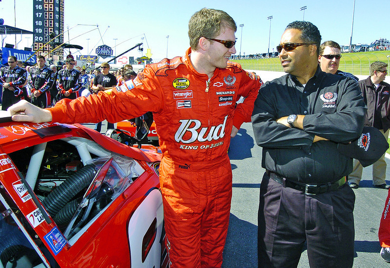 From left, driver Dale Earnhardt Jr. and President of Global Operations for Dale Earnhardt Inc. Max Siegel laugh and talk before the start of the Pep Boys 500 Race in Atlanta.