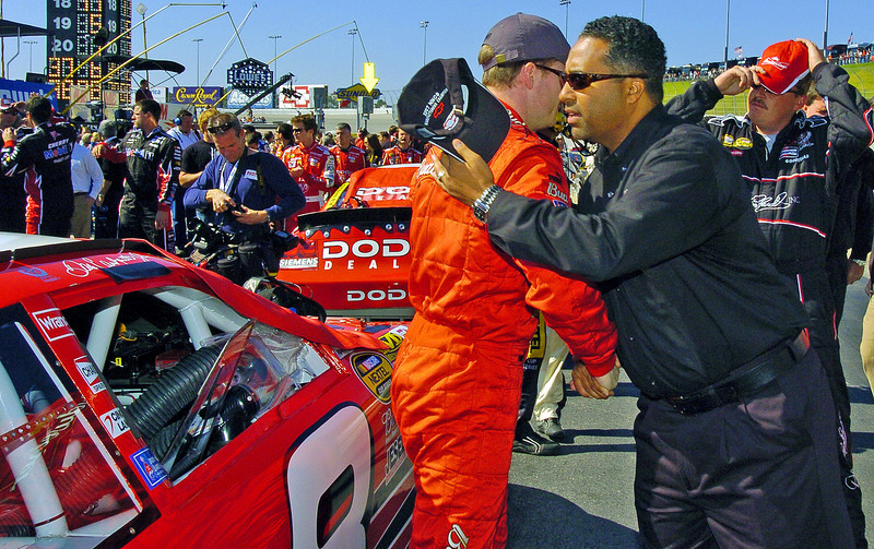From left, driver Dale Earnhardt Jr. and President of Global Operations for Dale Earnhardt Inc. Max Siegel shake hands and do the man hug shoulder thing as Max tells Dale to be safe and win this race before the start of the Pep Boys 500 Race in Atlanta.
