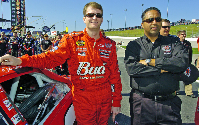 From left, driver Dale Earnhardt Jr. and President of Global Operations for Dale Earnhardt Inc. Max Siegel stand together for the starting ceremonies of the Pep Boys 500 Race in Atlanta.<br /> PHOTO BY JOE LIVINGSTON/STAFF