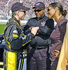From left, driver Mark Martin speaks to the President of Global Operations for Dale Earnhardt Inc. Max Siegel and his wife before  the starting ceremonies of the Pep Boys 500 Race in Atlanta.<br /> PHOTO BY JOE LIVINGSTON/STAFF