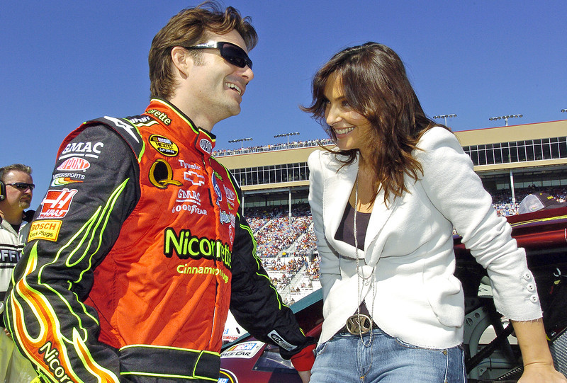 From left, NASCAR driver Jeff Gordon and his wife Ingrid laugh and talk before the start of the Pep Boys 500 Race in Atlanta.