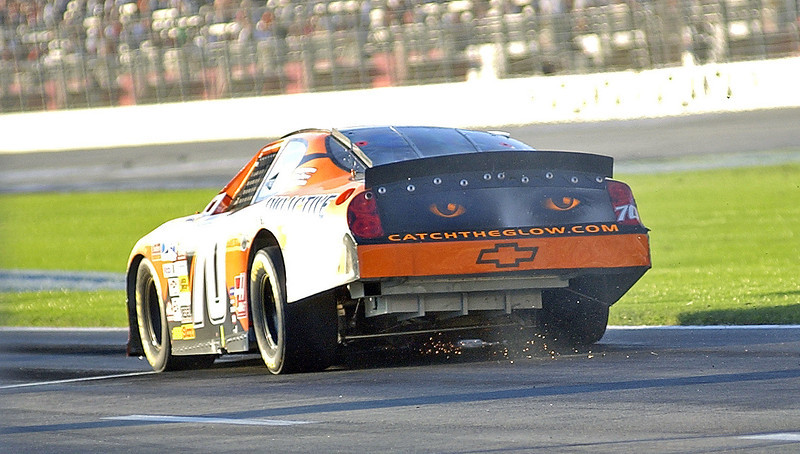 Driver Johnny Sauter in the # 70 car limps down Pit Road with his car throwing sparks and spewing fluids during the Pep Boys 500 in Atlanta.