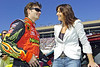 From left, NASCAR driver Jeff Gordan and his wife Ingrid laugh and talk before the start of the Pep Boys 500 Race in Atlanta.