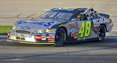 Pep Boys 500 Race Winner Jimmie Johnson pulls into Pit Road with the winning checker flag after his win in Atlanta.