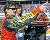 From left, NASCAR driver Jeff Gordon and his wife Ingrid look up at airplanes flying over as part of the ceremonies before the start of the Pep Boys 500 Race in Atlanta.