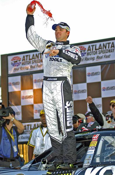 10-28-07 NASCAR <br /> Pep Boys 500 Race Winner Jimmie Johnson celebrates after his win in Atlanta.
