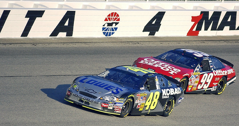 Pep Boys 500 Race Winner Jimmie Johnson and second place finisher Carl Edwards make the final turn toward the checker flag after his win under the caution flag in Atlanta.