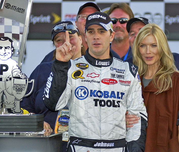 Pep Boys 500 Race Winner Jimmie Johnson and his wife Chandra pose for the media after his win in Atlanta.