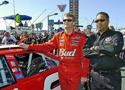 From left, driver Dale Earnhardt Jr. and President of Global Operations for Dale Earnhardt Inc. Max Siegel stand together for the starting ceremonies of the Pep Boys 500 Race in Atlanta.