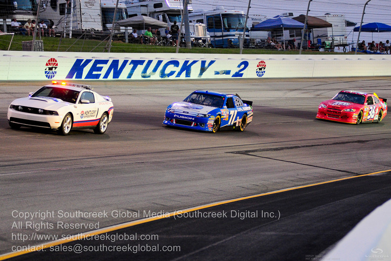 Official pace car and TRG Motorsports driver Andy Lally (71)in the TGR Motorsports Ford with Tommy Baldwin Racing driver Dave Blaney (36) in the Big Red Chevrolet while under cation during the NASCAR Inaugural Quaker State 400 at the Kentucky Speedway Sparta,Kentucky.