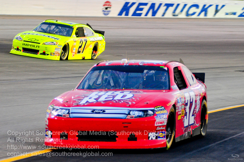 FAS Lane Racing driver Mike Bliss (32) in the Big Red Ford during the NASCAR Inaugural Quaker State 400 at the Kentucky Speedway Sparta,Kentucky.