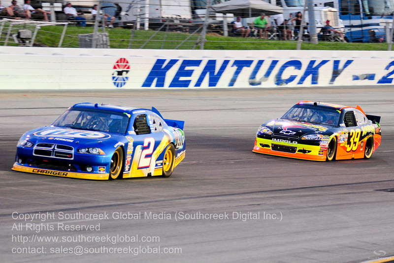 Penske Racing driver Brad Keselowski (2) in the Miller Lite Dodge and Stewart-Haas Racing driver Ryan Newman (39) in the Tornados Chevrolet during the NASCAR Inaugural Quaker State 400 at the Kentucky Speedway Sparta,Kentucky.