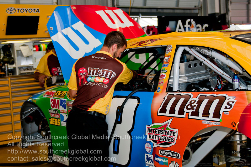 Joe Gibbs Racing (18) in the M&M's Toyota garage before the NASCAR Inaugural Quaker State 400 at the Kentucky Speedway Sparta,Kentucky.