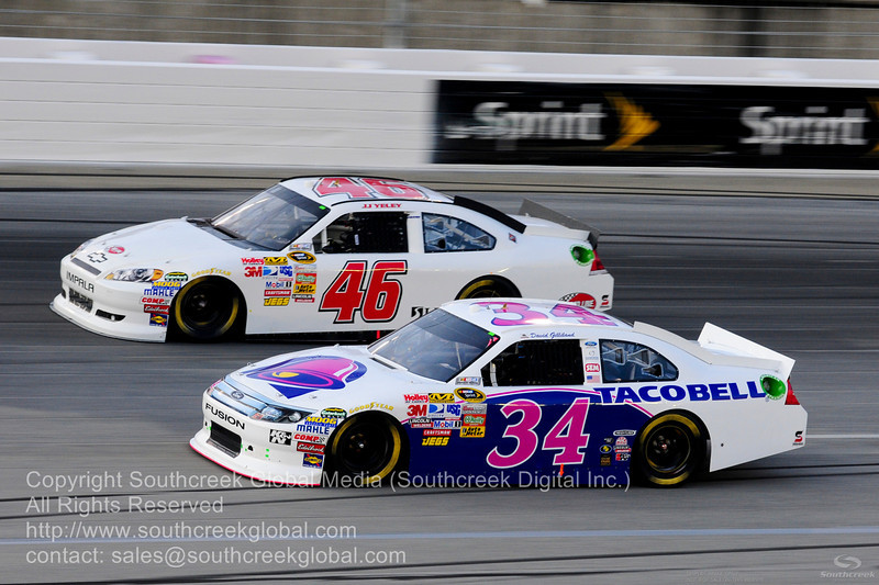 Front Row Motorsports driver David Gilliland (34) in the Taco Bell Ford and Sprint Cup Series driver J.J. Yeley (46) during the NASCAR Inaugural Quaker State 400 at the Kentucky Speedway Sparta,Kentucky.