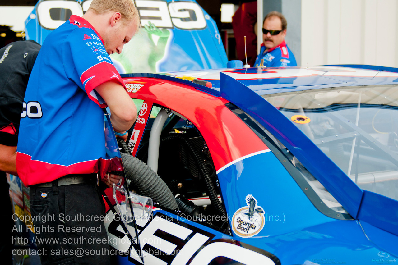 Germain Racing Team (13) in the Geico Toyota prepare for the NASCAR Inaugural Quaker State 400 at the Kentucky Speedway Sparta,Kentucky.